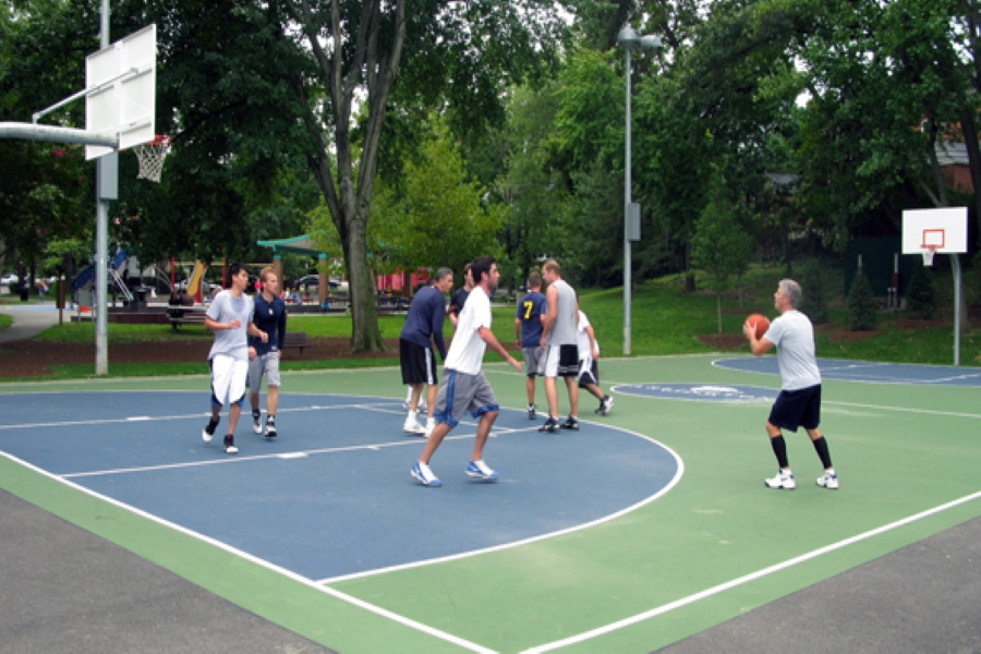 Playing basketball in a park